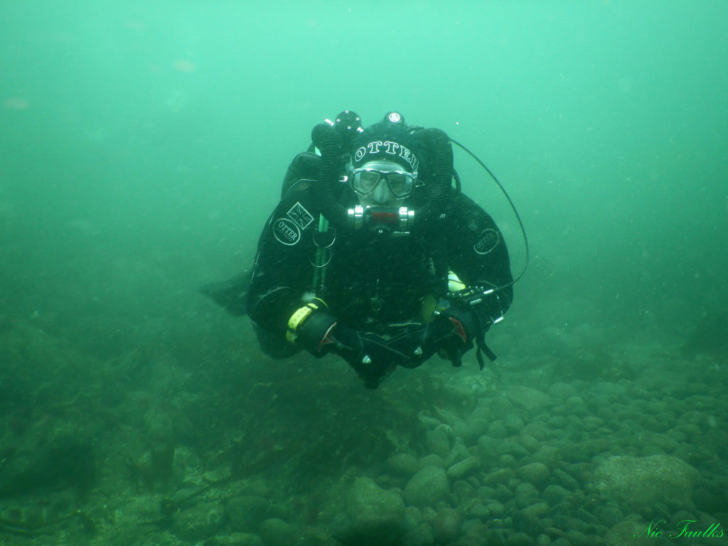 Dave Woodwood on his rebreather hovering over the seabed.