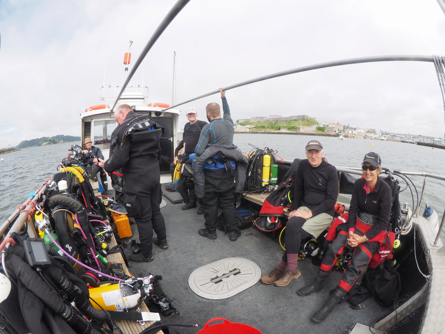 Divers sitting on the boat
