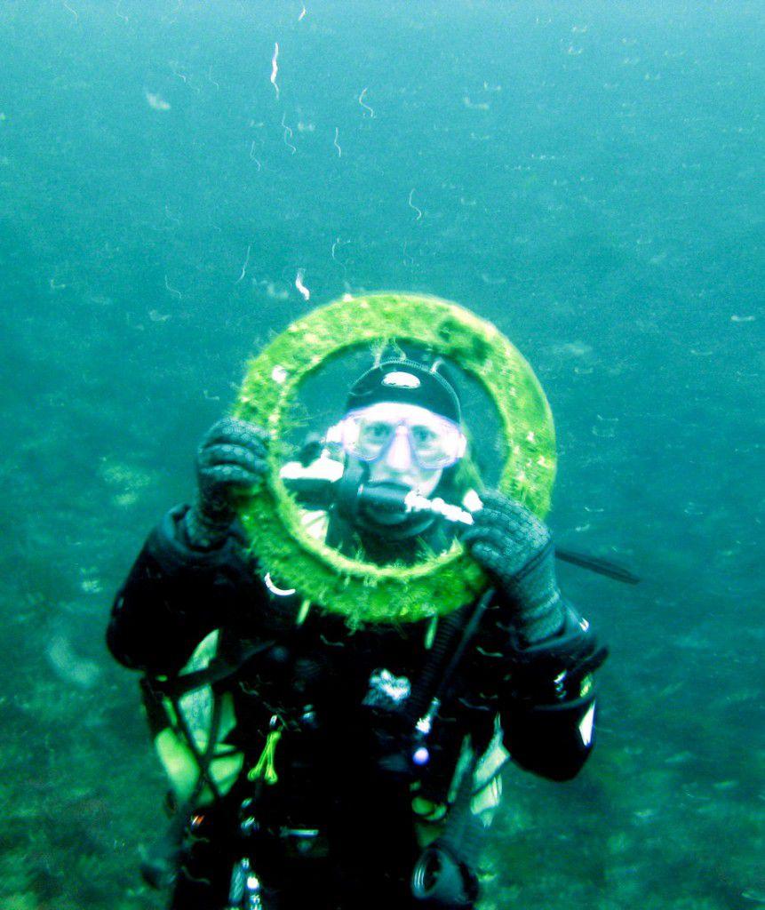 Diver holding porthole