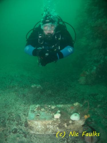 Tony hovering above a boat battery - At Abbs.